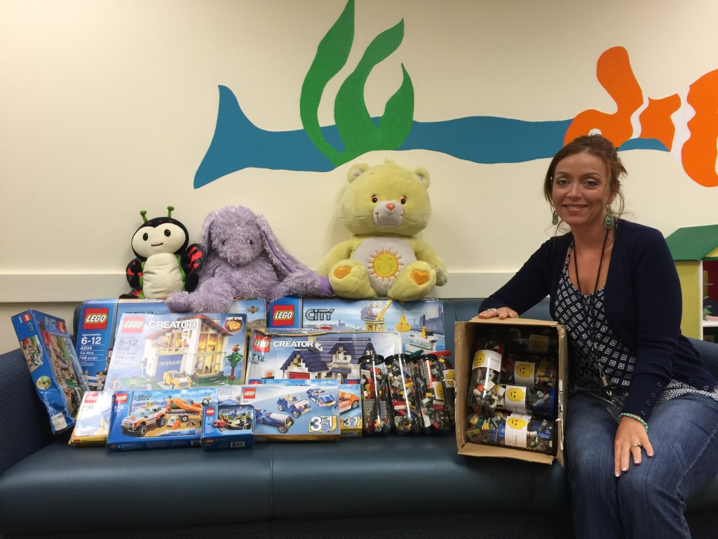 Chrystal of SAFE Center pictured with our donation.