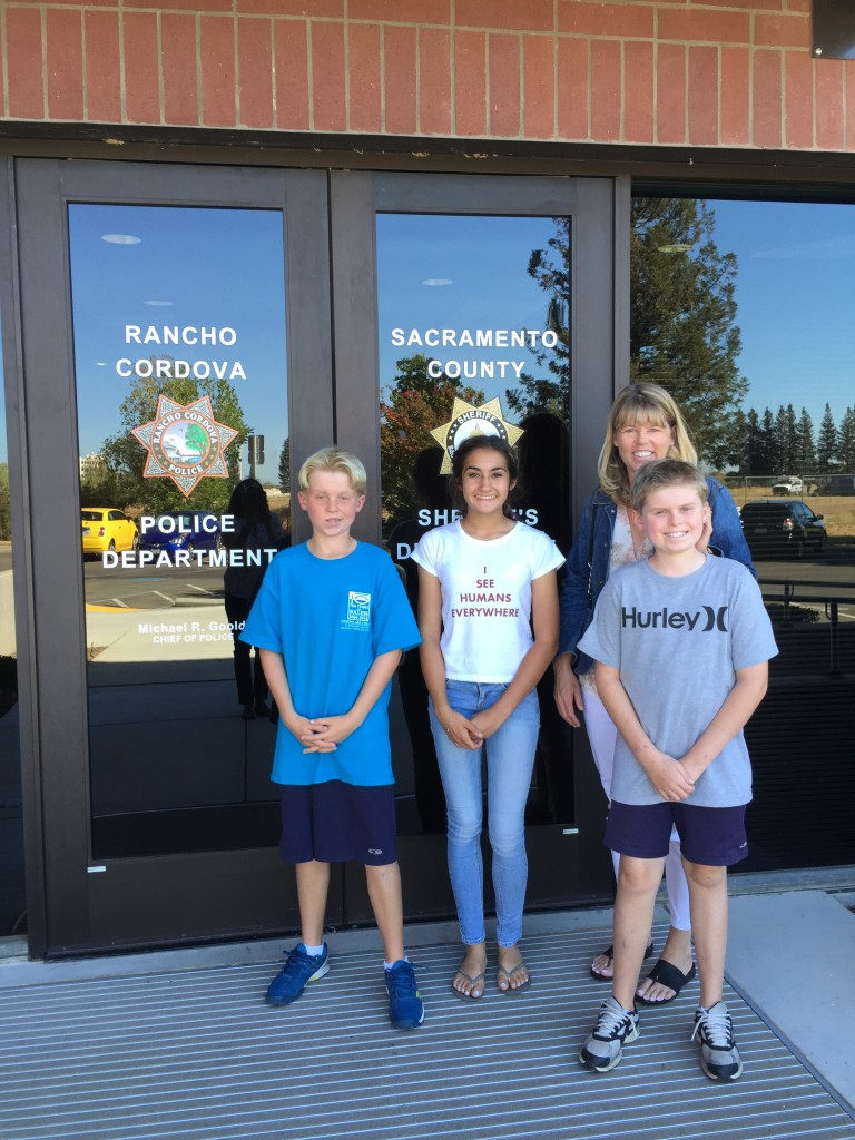 Kyle Rutz, Maya Snow, Susan Rutz, and Lleyton Rutz outside Rancho Cordova PD.  September 22, 2015.