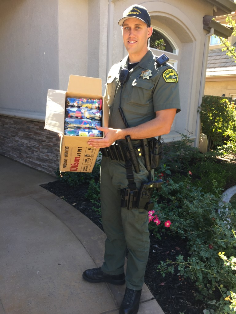 Deputy Sheriff Brandon Cecchetini accepting BrickDreams LEGO donation. 9/26/2015