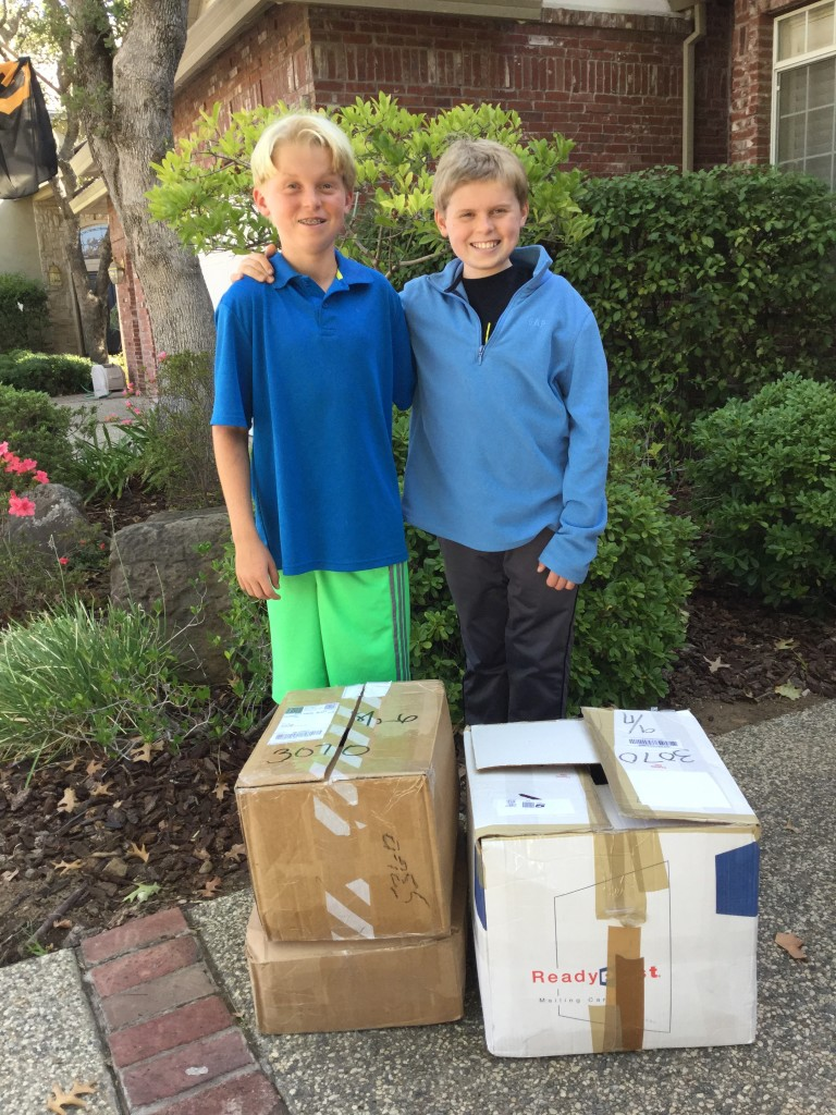 Kyle Rutz and Lleyton Rutz with LEGO donation from Ali Bleecker and family of Wilmette, IL