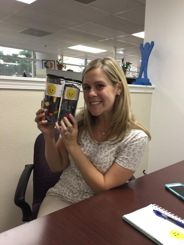 Megan Boespflug, Development Director of CASA accepting a BrickDreams donation.